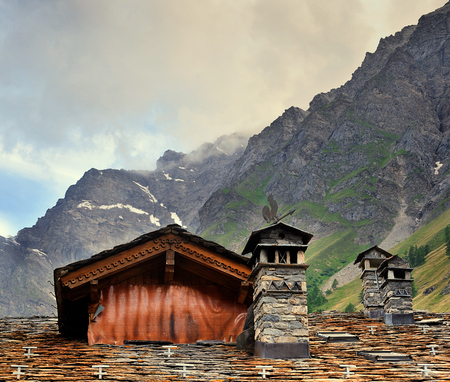 coatings: Roofs of old alpien architecture with chimneys in Rhemes Notre Dame, Valle Aosta