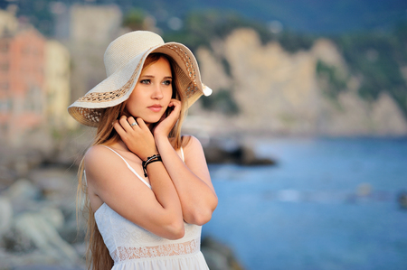 portret of dreamy girl in the hat on Mediterranean coast Stock Photo