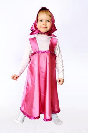 Baby girl in costumes of Masha from cartoon Masha and Bear