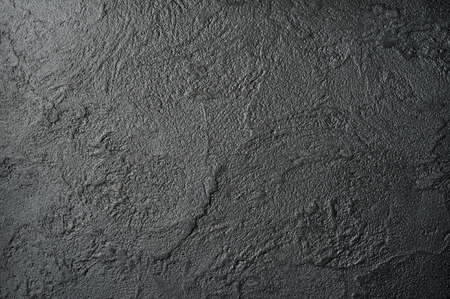 concave: Black wall with rich and various texture.