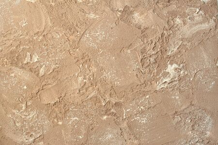 spattered: light brown background decorative plaster on rough relief