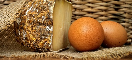 Sbarro cheese with grain encrusted on rural burlap with eggs Stock Photo