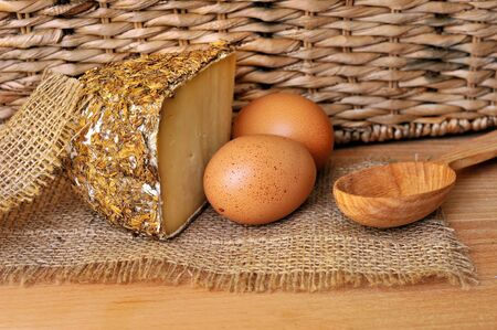 sectioned: Sbirro type of italian cheese with countrified background