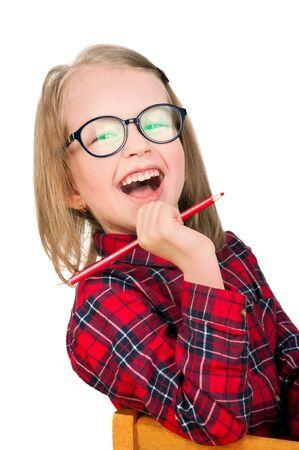 Happy schoolgirl in eyeglasses with a pencil