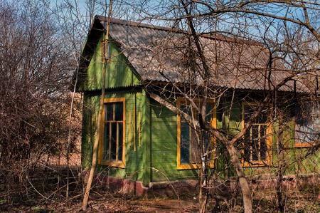 Small shack in spring garden Stock Photo