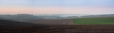 panoramic appearance of colored lines of cultivated fields