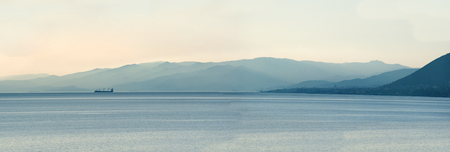 Panoramic view of ship at cold light with mountains