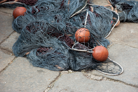 Gray fishing tackle and nets in the Italian port