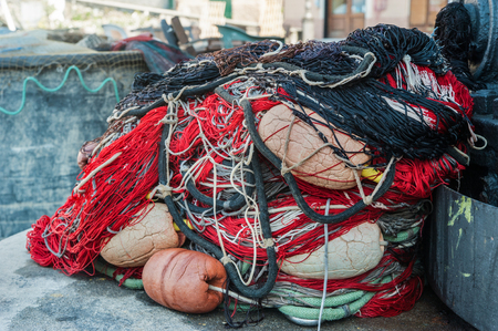 Colorful fishing gear, tackle and nets in the Italian port Stock Photo