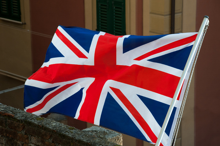 British Union Jack flag and aerial view with buildings background