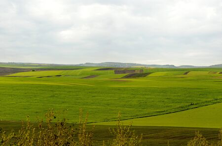 panoramic view of geometric patchwork of gardens, agricultural lands, farmland in springtime Stock Photo