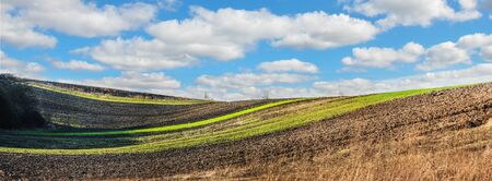 panoramic view of hilly lines with cloudly sky Banque d'images