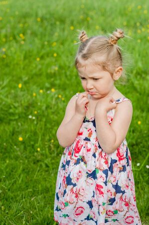 little girl in a summer dress, bad mood, resentment