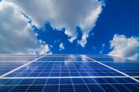 Solar energy panel power system, view up on and sky with clouds Stock Photo