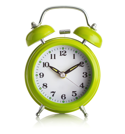 green and white: Old-fashioned alarm-clock on white background