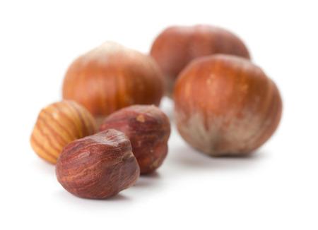 cobnut: closeup view of few hazelnuts on white background