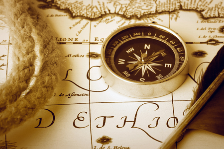 antique map: compass, rope, stylus and inkwell on old antique map Stock Photo
