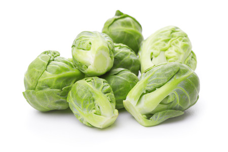 heap: heap of brussels sprouts isolated on white background Stock Photo