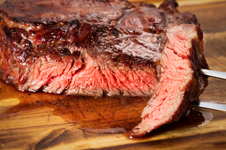 fillets: medium roast rib-eye steak on wooden background Stock Photo