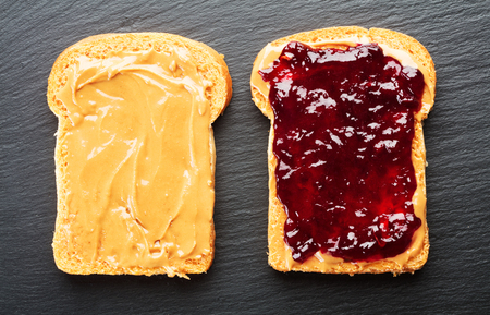 peanut butter and jelly sandwich: sandwich with peanut butter and jelly on slate background