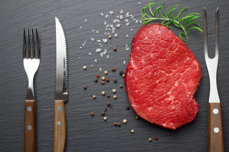 raw steak with salt and pepper on slate plate 스톡 콘텐츠