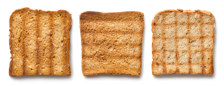 close-up view on three roasted toasts on white background