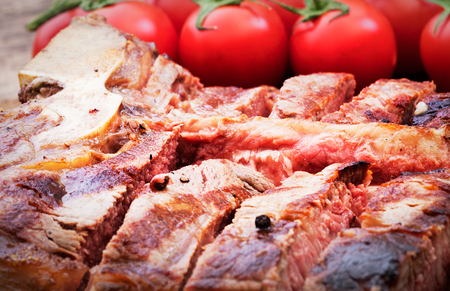 close-up view of sliced t-bone steak on wooden background 스톡 콘텐츠 - 108354778
