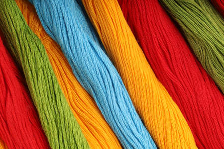 Colored threads for embroidery background