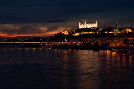 bratislava at night with renovated castle on the top of the hill