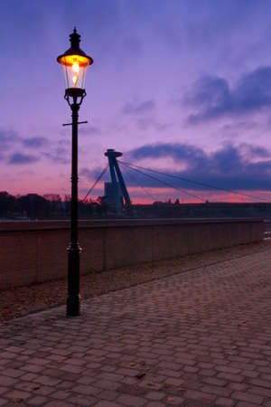 the danube: sunset with lamp near the river danube in bratislava Stock Photo