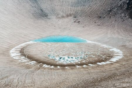 Ice lake in the crater of Gorely volcano, Kamchatka, Russia