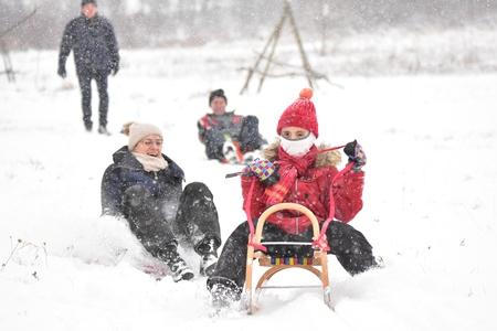 ski walking: Happy Family sledding in winter on the snow