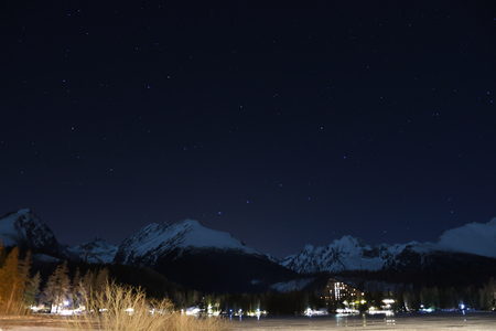Scenery of snow covered High Tatras mountains during night sunshine Slovakia