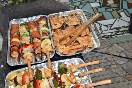 Grilled bacon and vegetables outdoors in the garden
