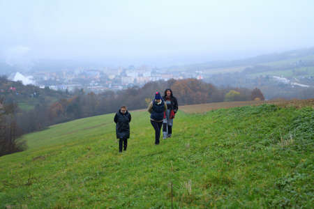 The family climbs up the hill together on a nature hike