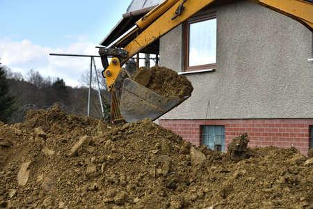 Detail of a shovel excavator that dumps soil while digging