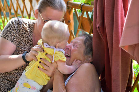Grandmother rejoices and smiles from the grandgirl and they have family joy