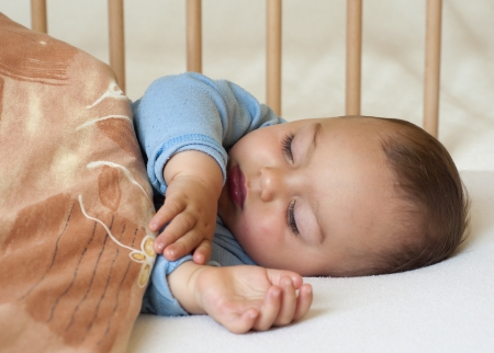 blue blanket: Portrait of a little baby boy sleeping under a  blanket  Stock Photo