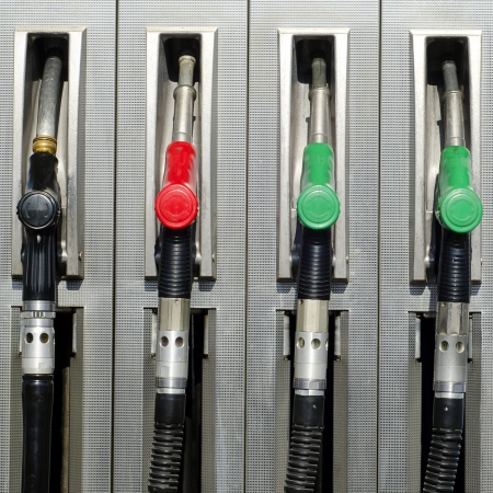 Four refuel nozzles at a petrol or gas station
