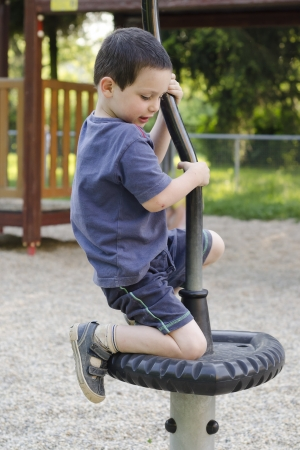 Child playing on modern playground equipment. photo