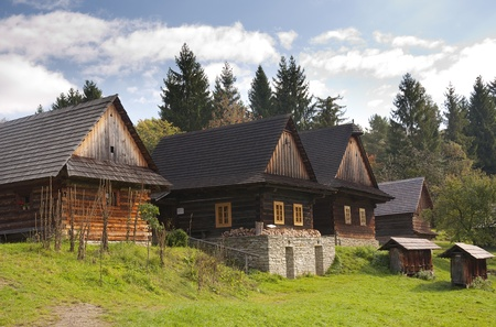 wooden houses: Wooden houses in rural countryside, Roznov pod Radhostem, Czech Republic Stock Photo