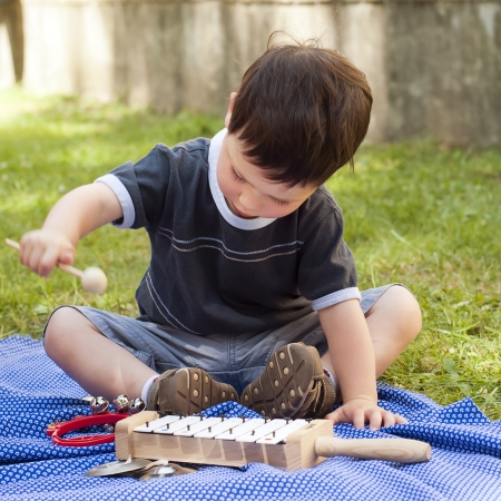 Child with musical instruments photo