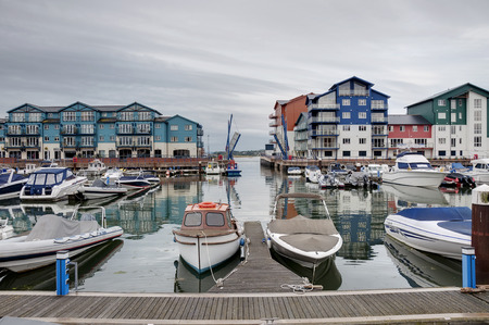 devon: View of a port and modern seaside houses and apartments in Exmouth marina, Devon, England, UK  Stock Photo