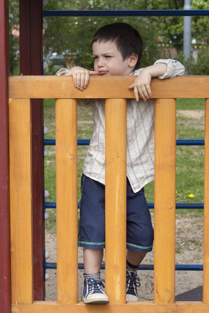 Portrait of a happy child boy at a playground. photo