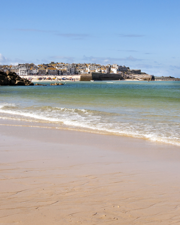 costal: View of typical english or british costal town with port and sandy beach; St. Ives, Cornwall, England, UK Stock Photo