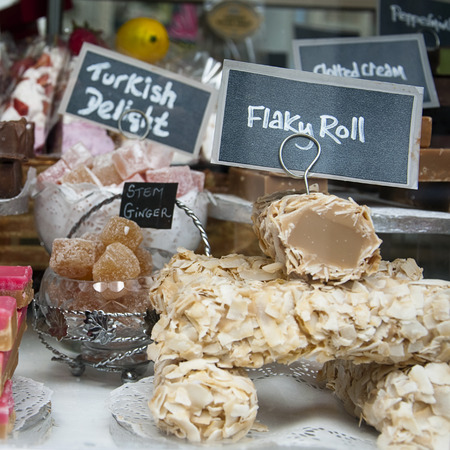 Fudge and turkish delight sweets on display in shop in Cornwall. photo
