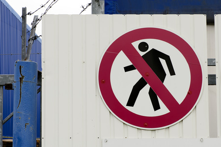 restricted: No entry sign on a gate at restricted access site  Stock Photo