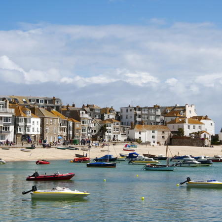 costal: View of typical british costal town with port and sandy beach; St. Ives, Cornwall, England, UK Editorial
