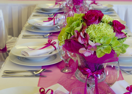 Wedding table setting arrangement in a luxury restaurant