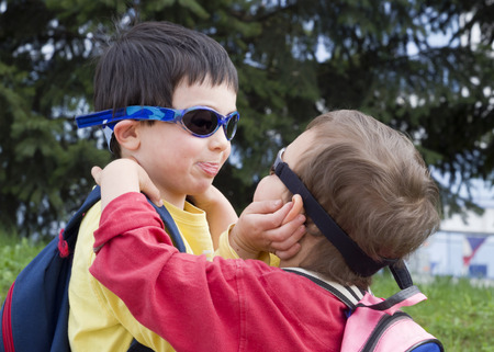 horseplay: Two children boys, brothers or friends, playing together and hugging outdoors. Stock Photo